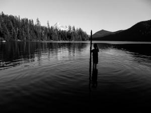 child-silhouette-in-lake